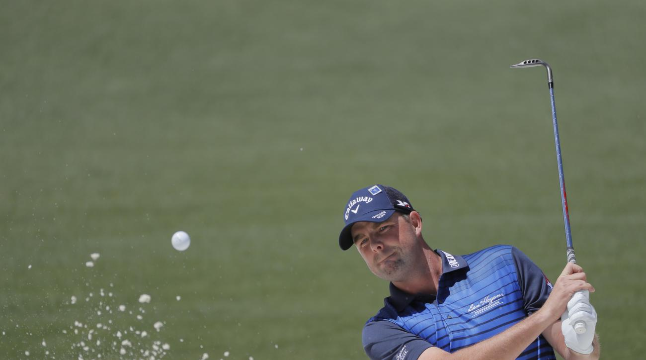 Marc Leishman, of Australia, hits from a bunker on the second hole during the second round of the Masters golf tournament Friday, April 8, 2016, in Augusta, Ga. (AP Photo/Jae C. Hong)