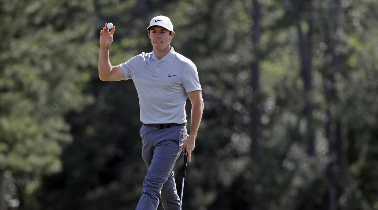 Rory McIlroy, of Northern Ireland, holds up his ball after putting out on the 18th hole during the second round of the Masters golf tournament Friday, April 8, 2016, in Augusta, Ga. (AP Photo/Chris Carlson)