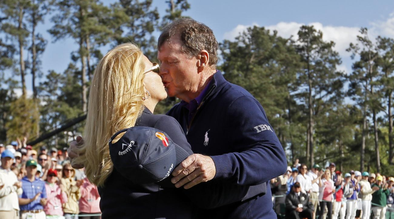 Tom Watson kisses his wife Hilary on the 18th hole after playing his last round at the Masters golf tournament Friday, April 8, 2016, in Augusta, Ga. (AP Photo/Chris Carlson)