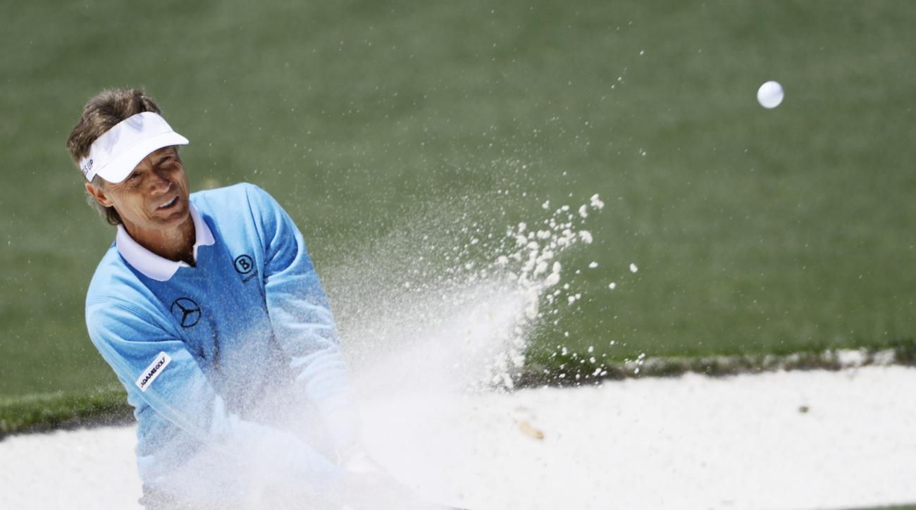 Bernhard Langer, of Germany, hits out of a bunker on the second green during the third round of the Masters golf tournament Saturday, April 9, 2016, in Augusta, Ga. (AP Photo/David J. Phillip)