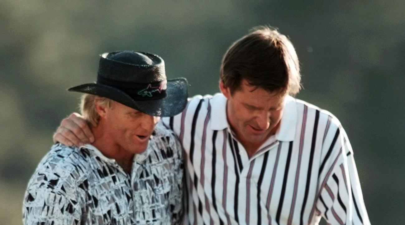 FILE - In this April 14, 1996, file photo, England's Nick Faldo, right, and Australia's Greg Norman walk off the 18th hole after Faldo won his third Masters golf tournament at the Augusta National Golf Club in Augusta, Ga. Faldo is the only multiple Maste