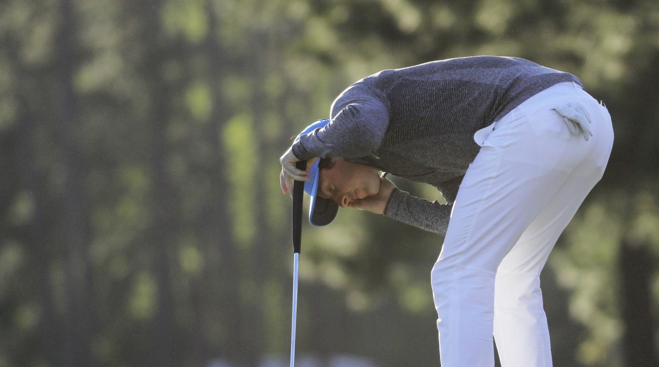 Rory McIlroy, of Northern Ireland, reacts after missing a birdie putt on the 17th green during the third round of the Masters golf tournament Saturday, April 9, 2016, in Augusta, Ga. (AP Photo/Chris Carlson)