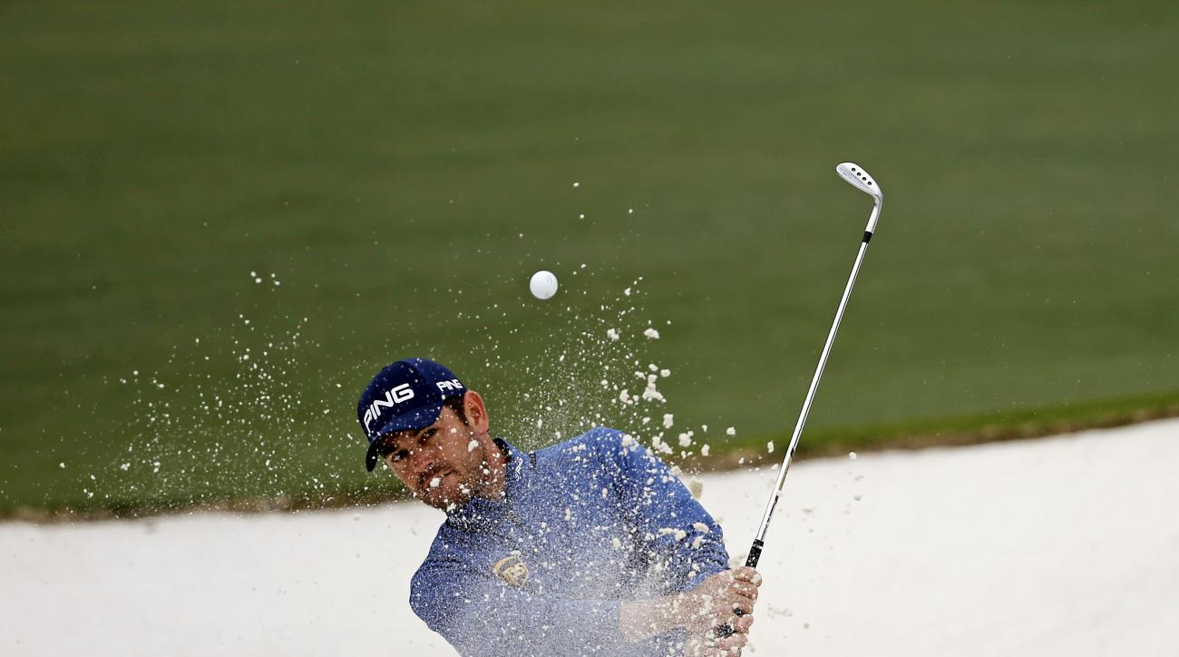 Louis Oosthuizen, of South Africa, chips out of a bunker on the second hole during the final round of the Masters golf tournament Sunday, April 10, 2016, in Augusta, Ga. (AP Photo/Matt Slocum)