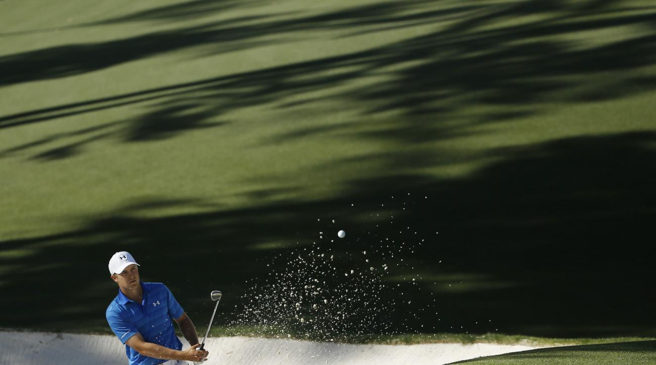Jordan Spieth hits out of a bunker on the 10th hole during the final round of the Masters golf tournament Sunday, April 10, 2016, in Augusta, Ga. (AP Photo/Matt Slocum)