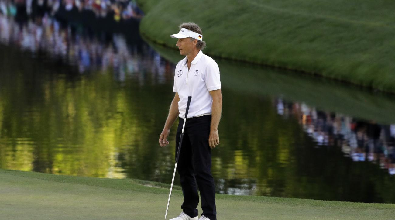 Bernhard Langer, of Germany, reacts after missing a putt on the 16th green during the final round of the Masters golf tournament Sunday, April 10, 2016, in Augusta, Ga. (AP Photo/Jae C. Hong)