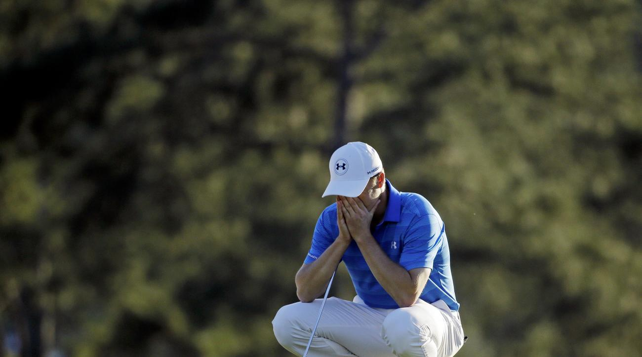 Jordan Spieth pauses on the 18th green before putting out during the final round of the Masters golf tournament Sunday, April 10, 2016, in Augusta, Ga. (AP Photo/Chris Carlson)