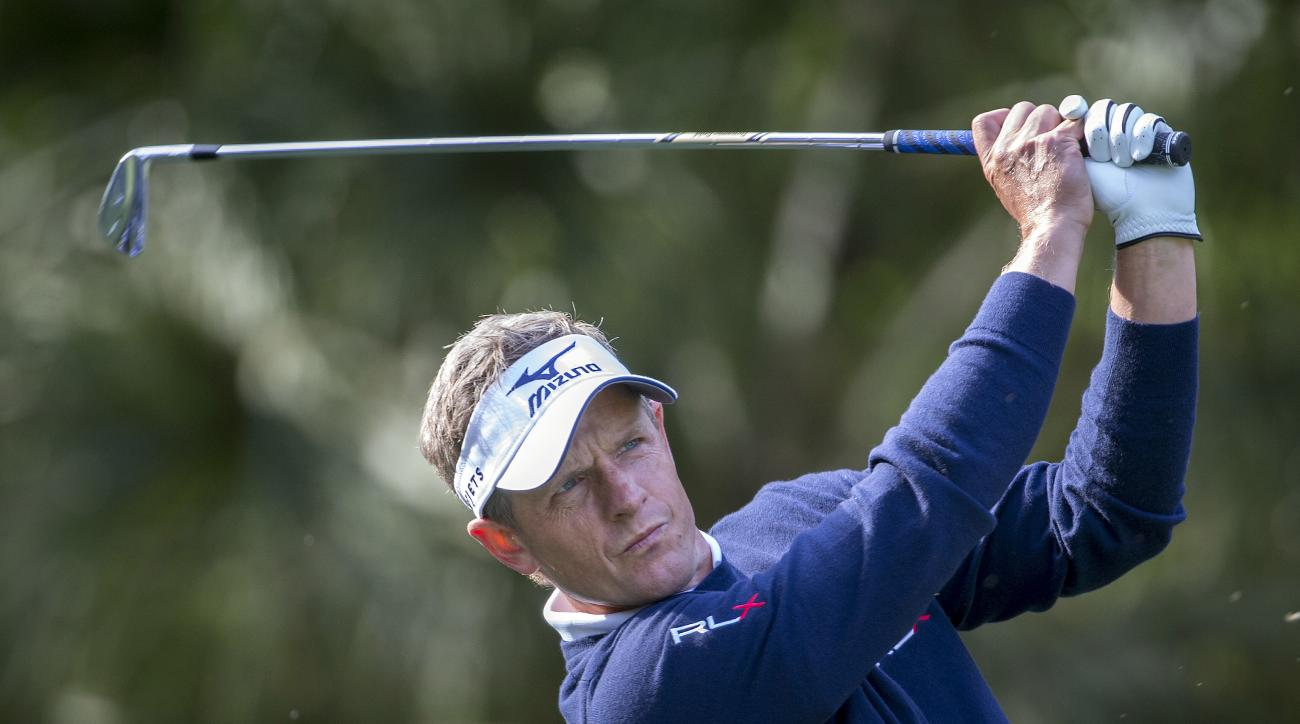 Luke Donald, of England, watches his shot on the 10th tee during the first round of the RBC Heritage golf tournament in Hilton Head Island, S.C., Thursday, April 14, 2016. (AP Photo/Stephen B. Morton)
