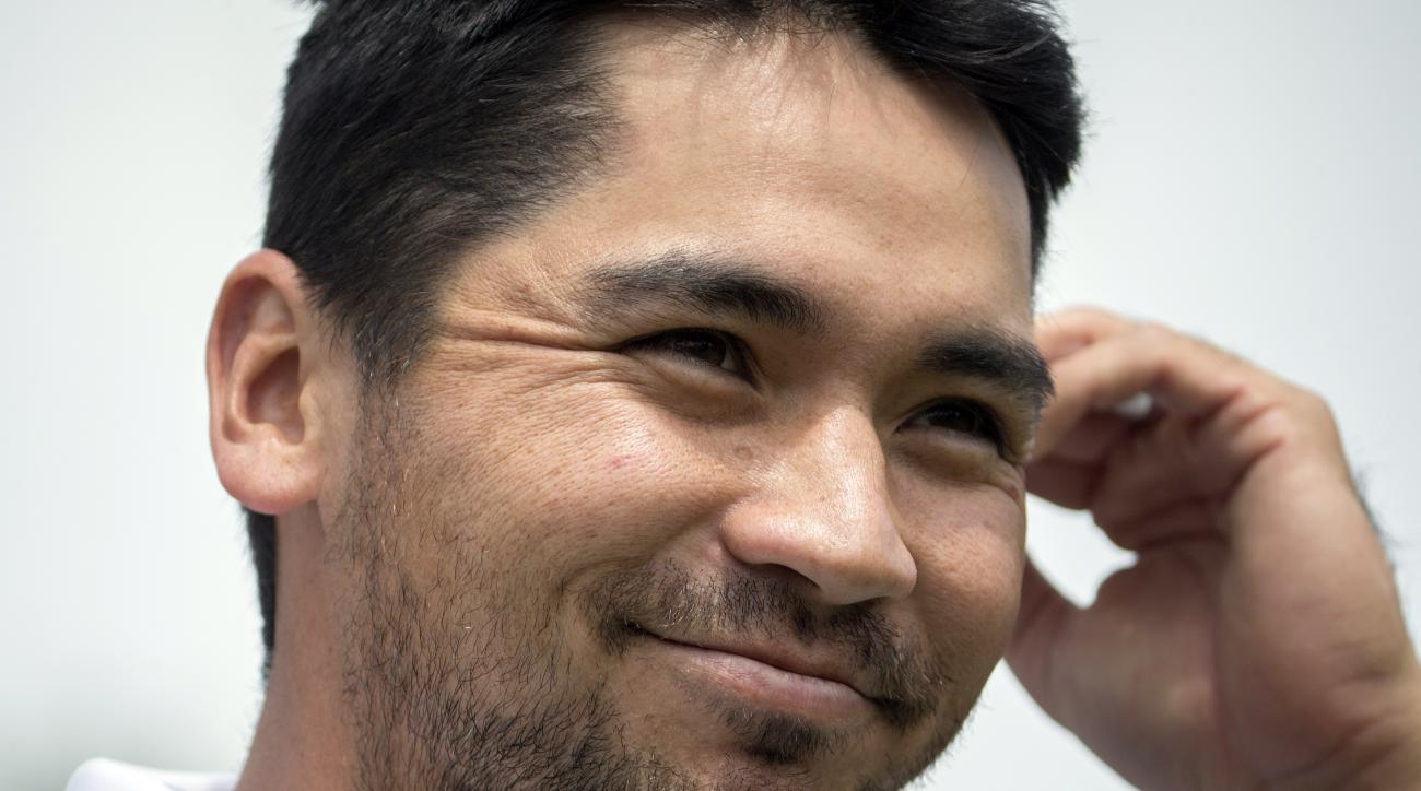 Jason Day, of Australia, smiles after being introduced on the first tee during the first round of the RBC Heritage golf tournament in Hilton Head Island, S.C., Thursday, April 14, 2016. (AP Photo/Stephen B. Morton)