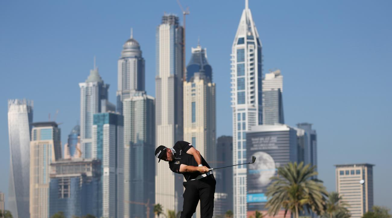 Andrew Johnston of England plays a ball on the 13th hole during the round one of the Dubai Desert Classic golf tournament in Dubai, United Arab Emirates, Thursday, Jan. 29, 2015. (AP Photo/Kamran Jebreili)