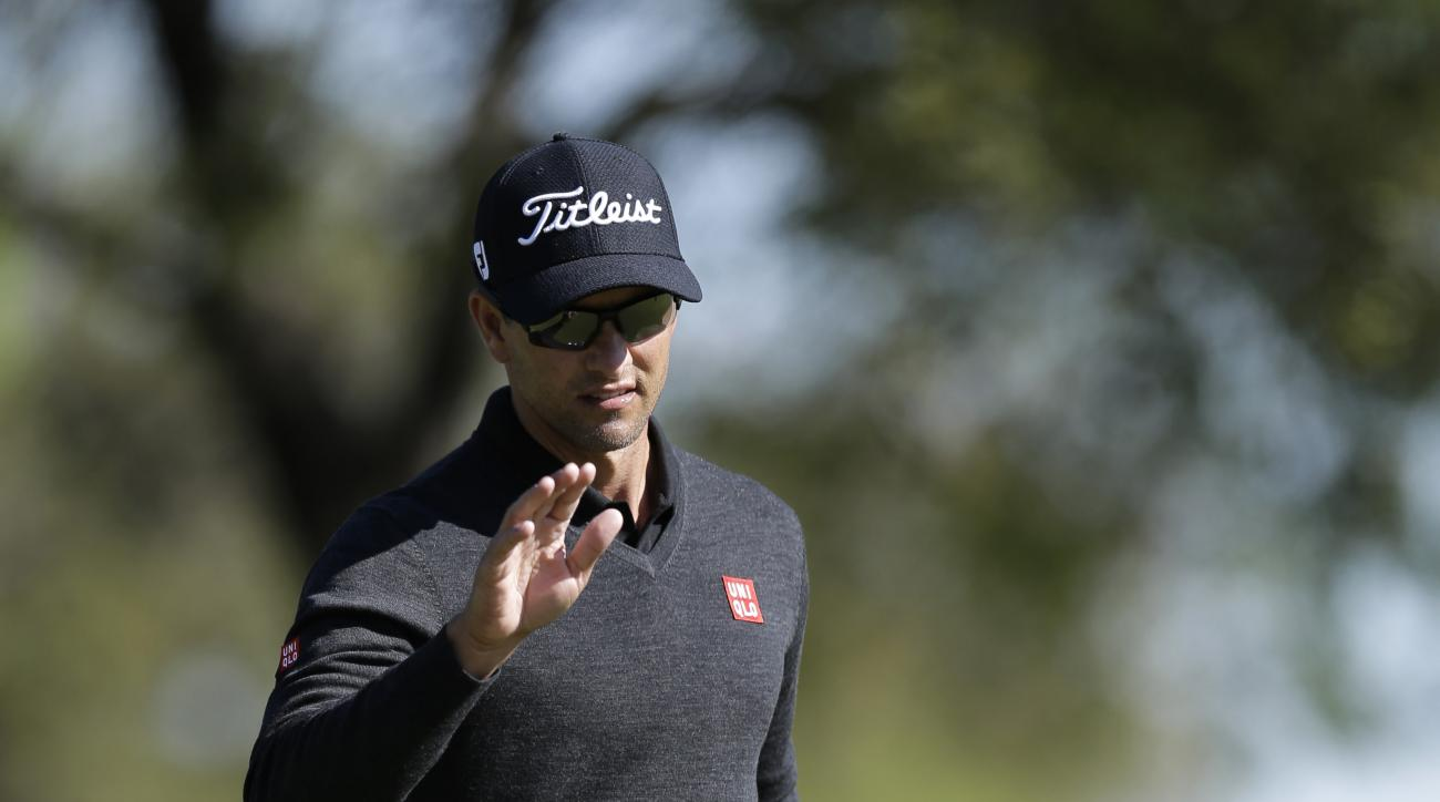 Adam Scott waves to the gallery after saving par on the first hole during round-robin play against Bill Haas at the Dell Match Play Championship golf tournament at Austin County Club, Friday, March 25, 2016, in Austin, Texas. (AP Photo/Eric Gay)