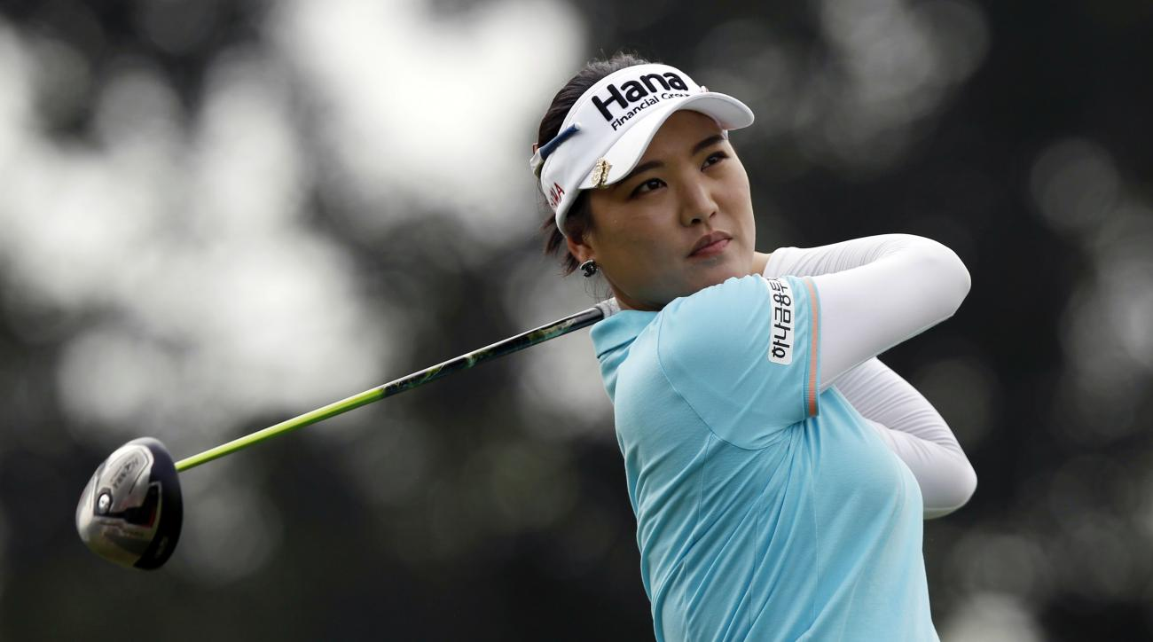 So Yeon Ryu of South Korea watches her shot from the sixth hole during the first round of the LPGA Malaysia golf tournament at Kuala Lumpur Golf and Country Club in Kuala Lumpur, Malaysia on Thursday, Oct. 8, 2015. (AP Photo/Joshua Paul)
