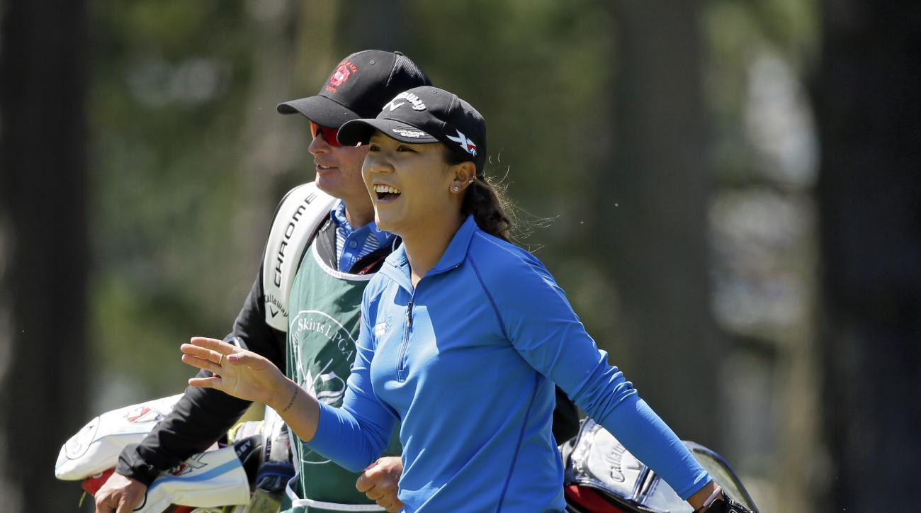 Lydia Ko, of New Zealand, smiles walking up the sixth fairway of the Lake Merced Golf Club during the second round of the Swinging Skirts LPGA Classic golf tournament Friday, April 22, 2016, in Daly City, Calif. (AP Photo/Eric Risberg)