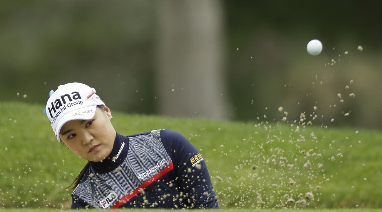 So Yeon Ryu, of South Korea, follows her shot from a bunker onto the second green of the Lake Merced Golf Club during the second round of the Swinging Skirts LPGA Classic golf tournament Friday, April 22, 2016, in Daly City, Calif. (AP Photo/Eric Risberg)