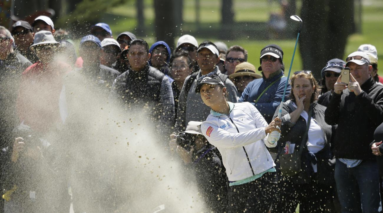 Lydia Ko, of New Zealand, follows her shot out of a bunker up to the first green of the Lake Merced Golf Club during the final round of the Swinging Skirts LPGA Classic golf tournament Sunday, April 24, 2016, in Daly City, Calif. (AP Photo/Eric Risberg)