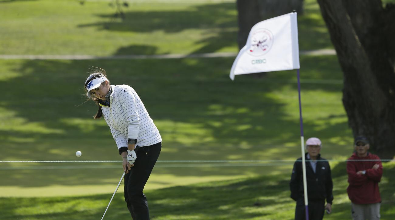 Gerina Piller chips the ball onto the eighth green of the Lake Merced Golf Club during the final round of the Swinging Skirts LPGA Classic golf tournament Sunday, April 24, 2016, in Daly City, Calif. (AP Photo/Eric Risberg)