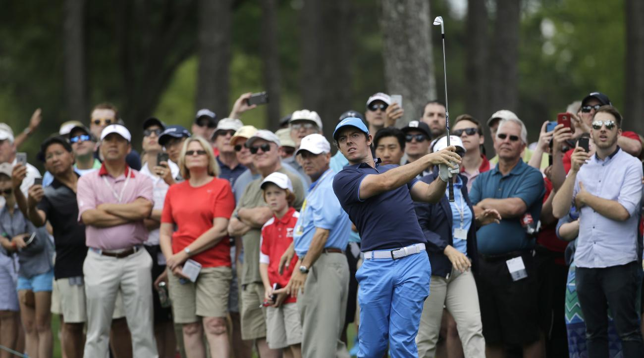 Rory McIlroy watches his approach shot on the first hole during the pro-am of the Wells Fargo Championship golf tournament at Quail Hollow Club in Charlotte, N.C., Wednesday, May 4, 2016. (AP Photo/Chuck Burton)