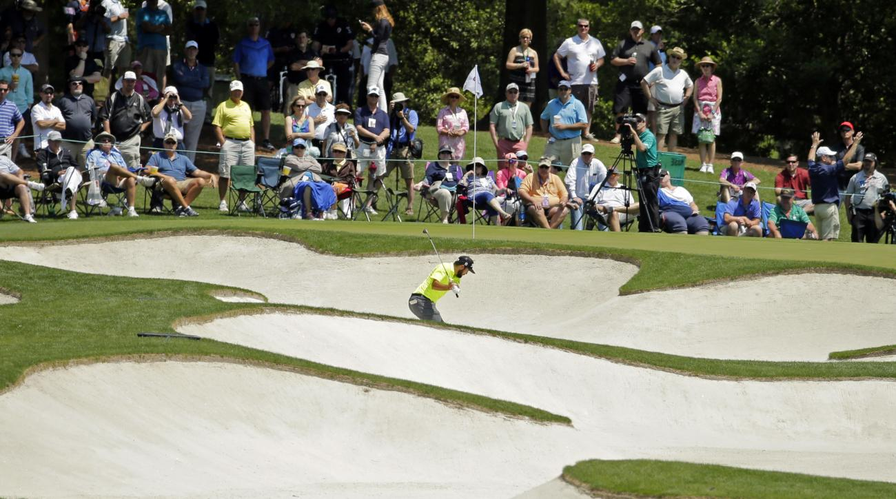 Mark Hubbard hits from a sand trap on the fifth hole during the third round of the Wells Fargo Championship golf tournament at Quail Hollow Club in Charlotte, N.C., Saturday, May 7, 2016. (AP Photo/Chuck Burton)