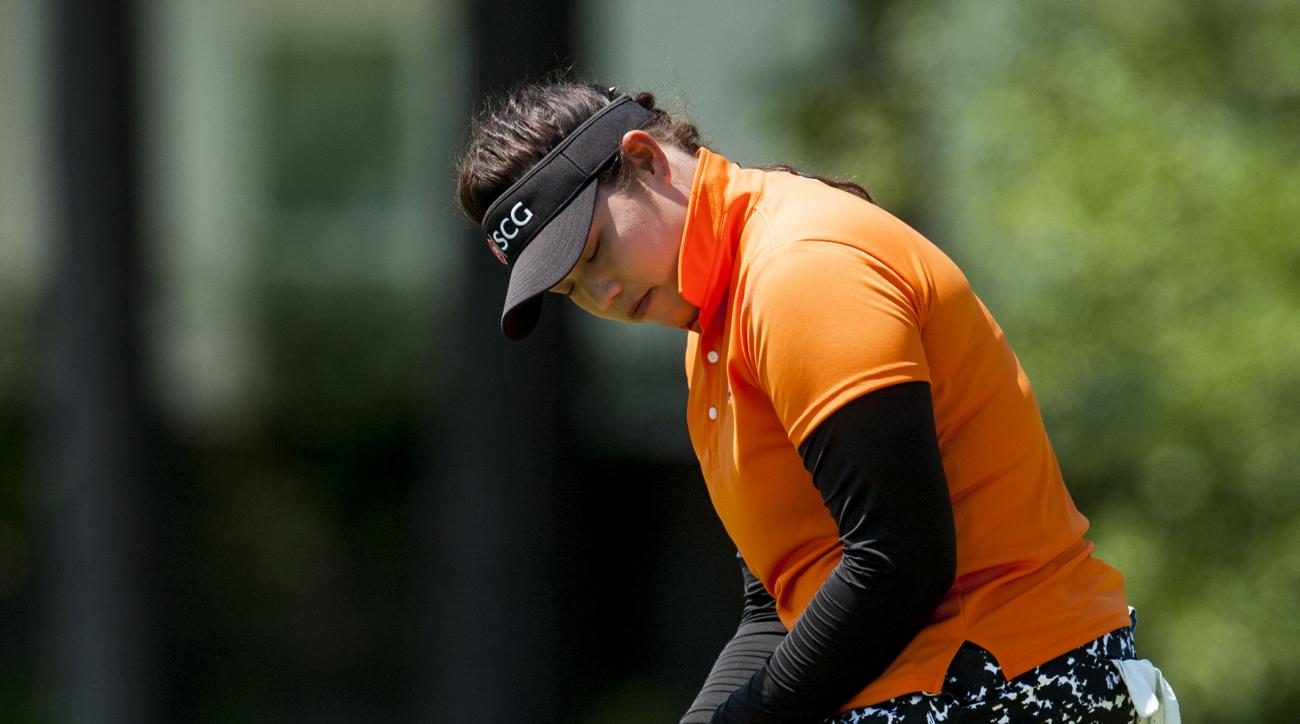 Ariya Jutanugarn reacts to sinking a birdie putt on 16 during round three of the Yokohama Tire LPGA Classic golf tournament in Prattville, Ala., Saturday, May 7, 2016. (Mickey Welsh/The Montgomery Advertiser via AP)  NO SALES; MANDATORY CREDIT