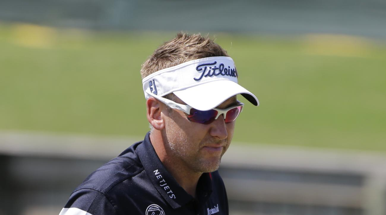Ian Poulter, of England, shows his ball after putting on the 18th green, during the first round of The Players Championship golf tournament Thursday, May 12, 2016, in Ponte Vedra Beach, Fla. (AP Photo/Chris O'Meara )
