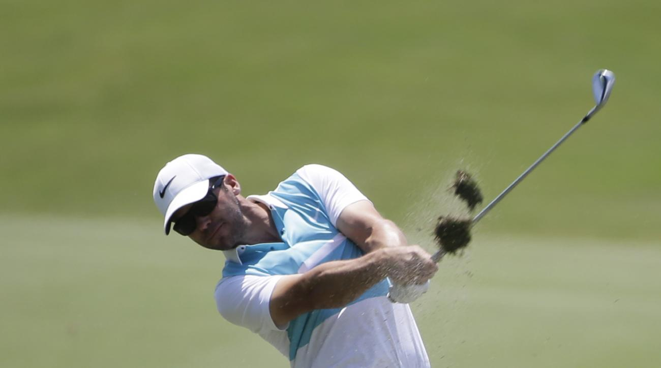 Paul Casey, of England, hits from the 18th fairway during the first round of The Players Championship golf tournament Thursday, May 12, 2016, in Ponte Vedra Beach, Fla. (AP Photo/Chris O'Meara)
