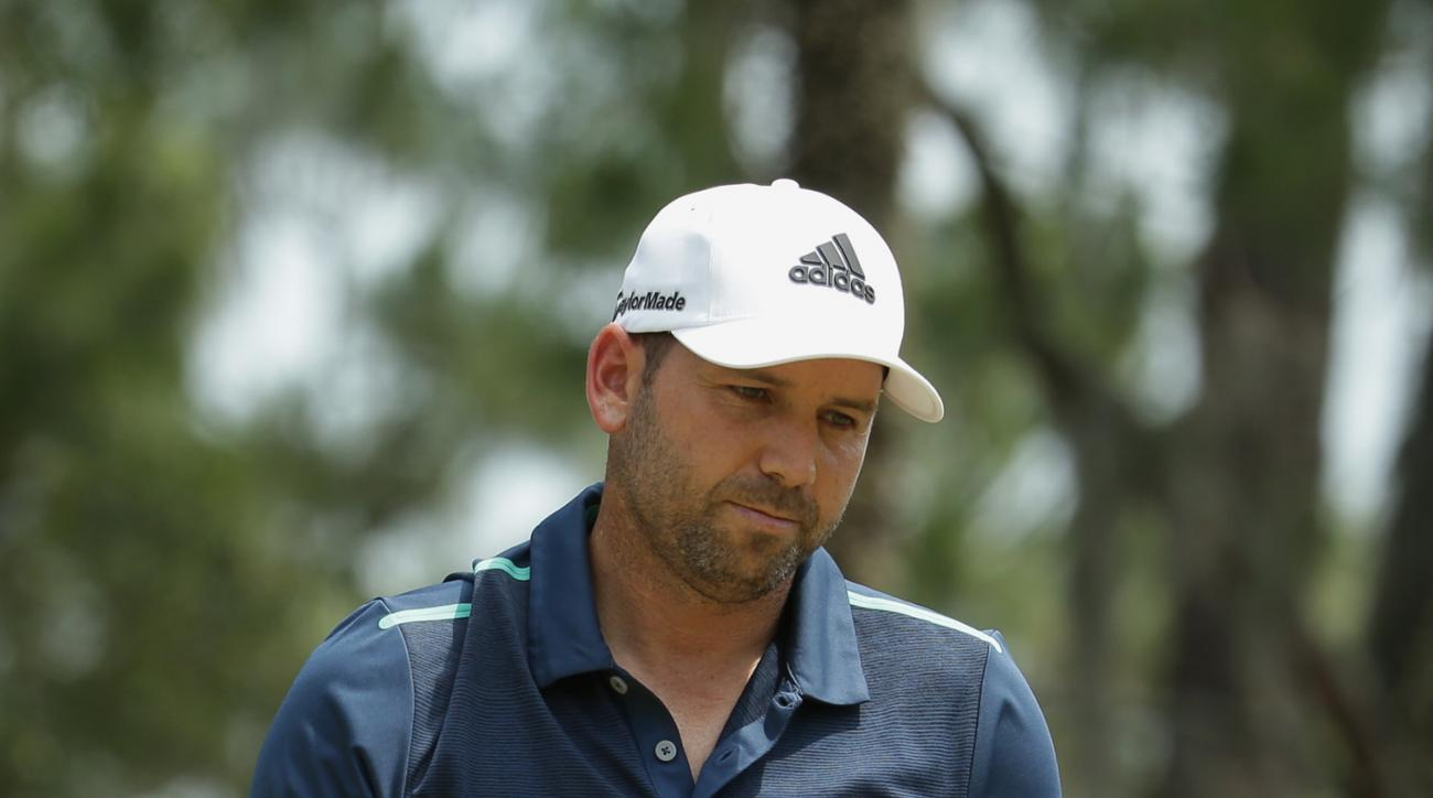 Sergio Garcia, of Spain, reacts after making a birdie putt on the fifth hole during the second round of The Players Championship golf tournament Friday, May 13, 2016, in Ponte Vedra Beach, Fla. (AP Photo/Lynne Sladky)