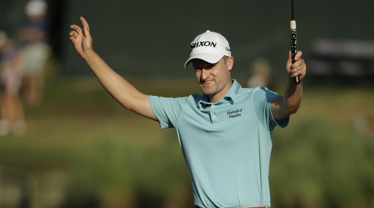 Russell Knox raises his arms after finally finishing the17th hole during the third round of The Players Championship golf tournament Saturday, May 14, 2016, in Ponte Vedra Beach, Fla. Knox hit three shots in the water, taking six-over-par nine on the hole