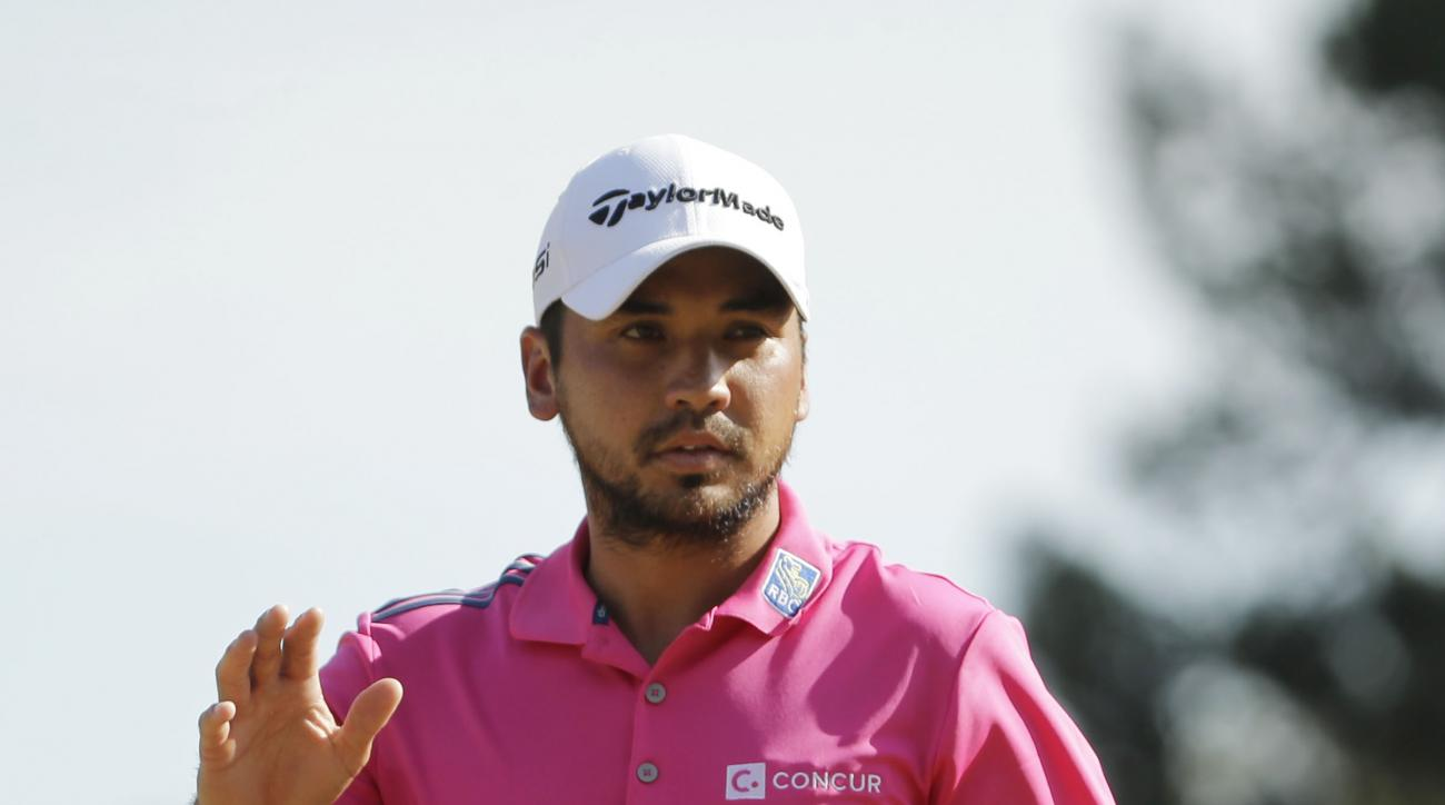 Jason Day of Australia, gestures after making a birdie putt on the 12th hole during the final round of The Players Championship golf tournament Sunday, May 15, 2016, in Ponte Vedra Beach, Fla. (AP Photo/Chris O'Meara)
