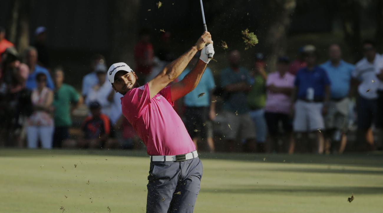 Jason Day of Australia, hits from the 15th hole fairway during the final round of The Players Championship golf tournament Sunday, May 15, 2016, in Ponte Vedra Beach, Fla. (AP Photo/Chris O'Meara)