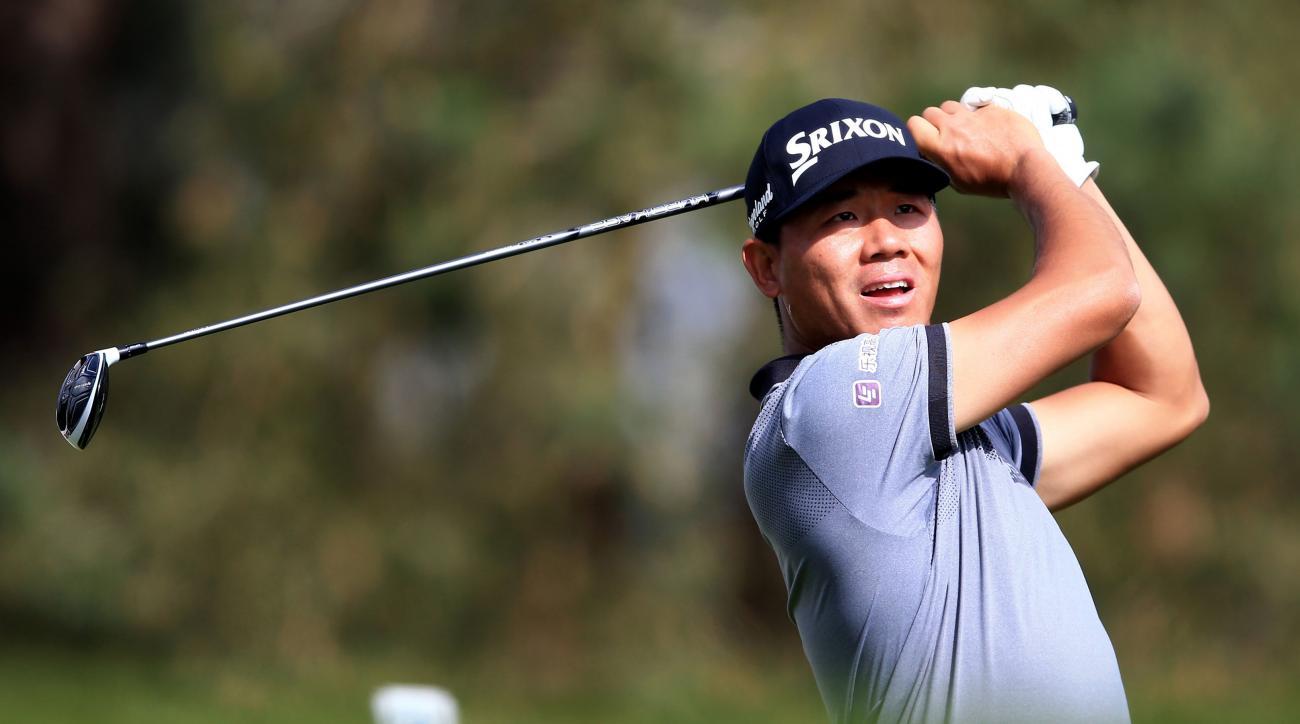 China's Wu Ashun plays a shot during the first round of the PGA Championship at Wentworth golf club, Virginia Water, England, Thursday May 26, 2016. (John Walton/PA via AP) UNITED KINGDOM OUT NO SALES NO ARCHIVE