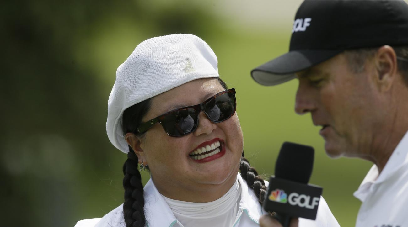 Christina Kim is interviewed after her first round of the LPGA Volvik Championship golf tournament at the Travis Pointe Country Club, Thursday, May 26, 2016, in Ann Arbor, Mich. (AP Photo/Carlos Osorio)