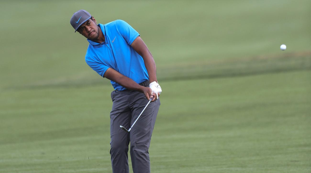 Tony Finau chips the ball to the green on the fifth hole during the second round of the Arnold Palmer Invitational golf tournament in Orlando, Fla., Friday, March 18, 2016. (AP Photo/Willie J. Allen, Jr.)