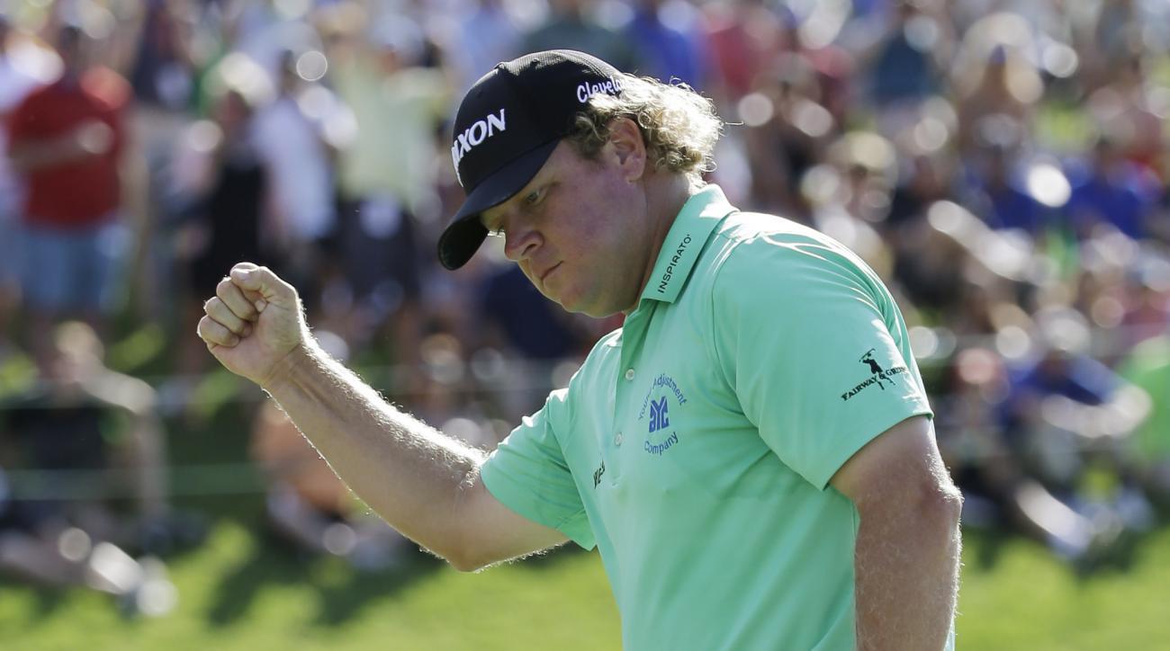 William McGirt celebrates after winning the Memorial golf tournament in a playoff, Sunday, June 5, 2016, in Dublin, Ohio. (AP Photo/Darron Cummings)