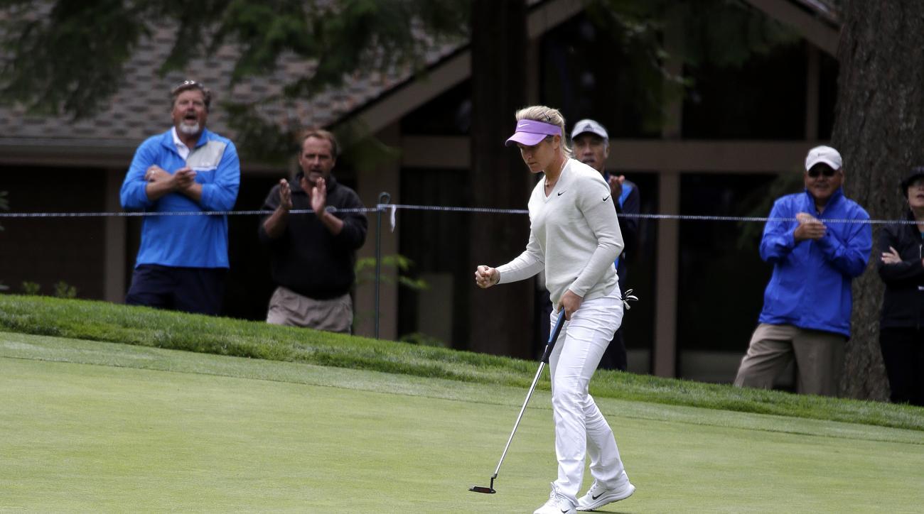 Suzann Pettersen, of Norway, pumps her fist after making a putt in the first round at the Women's PGA Championship golf tournament at Sahalee Country Club Thursday, June 9, 2016, in Sammamish, Wash. (AP Photo/Elaine Thompson)