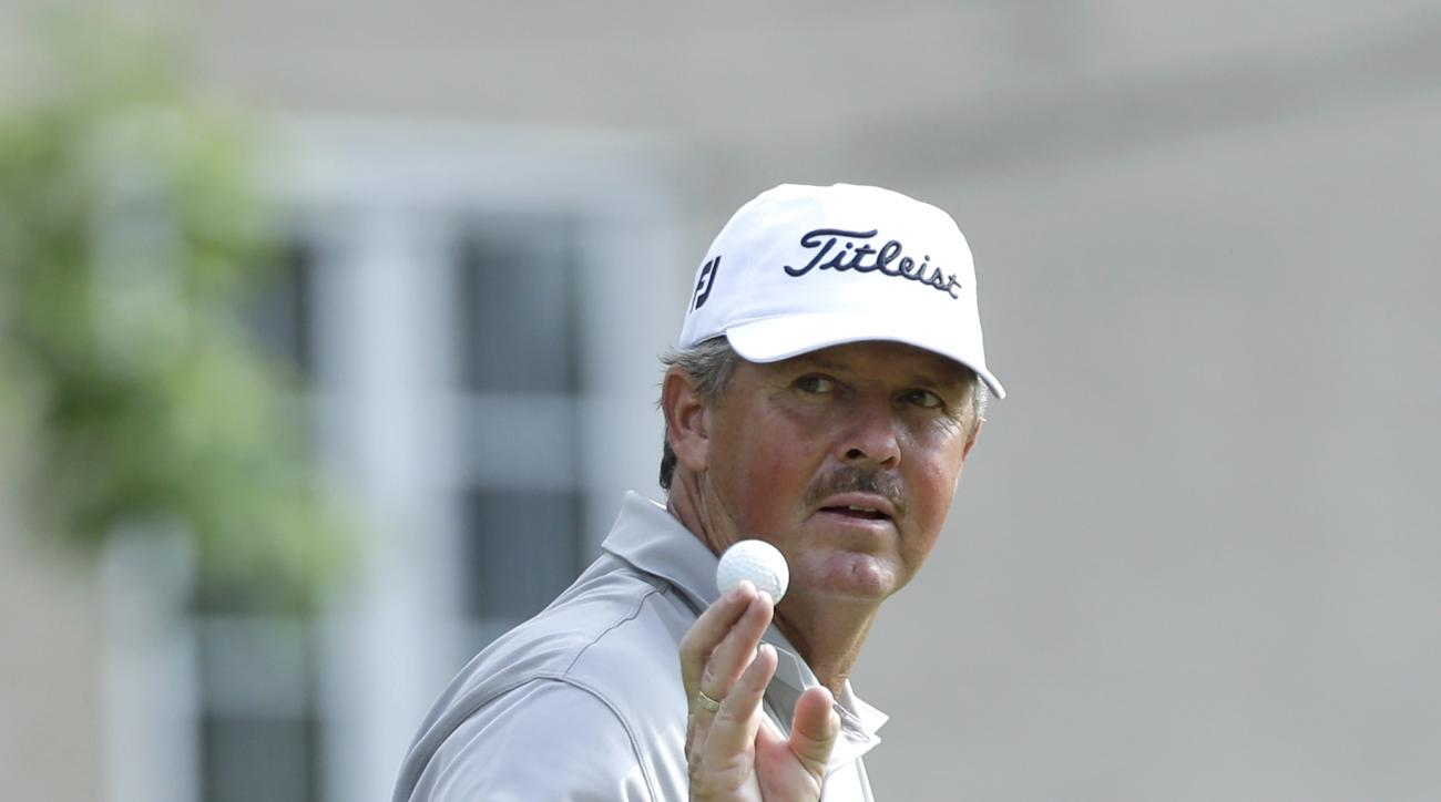 Jay Don Blake reacts after putting on the seventh hole during the first round of the U.S. Open golf tournament at Merion Golf Club, Thursday, June 13, 2013, in Ardmore, Pa. (AP Photo/Julio Cortez)