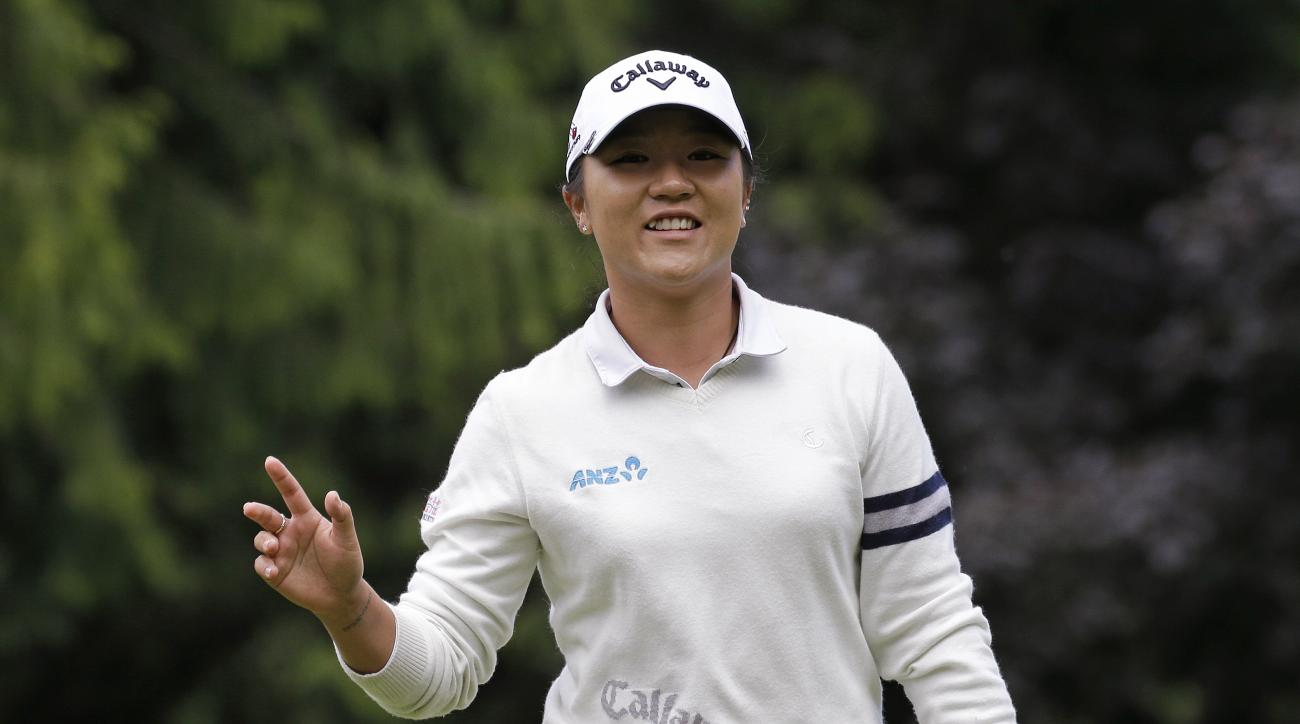 Lydia Ko, of New Zealand, waves after making a putt on the sixth hole in the third round at the Women's PGA Championship golf tournament at Sahalee Country Club Saturday, June 11, 2016, in Sammamish, Wash. (AP Photo/Elaine Thompson)