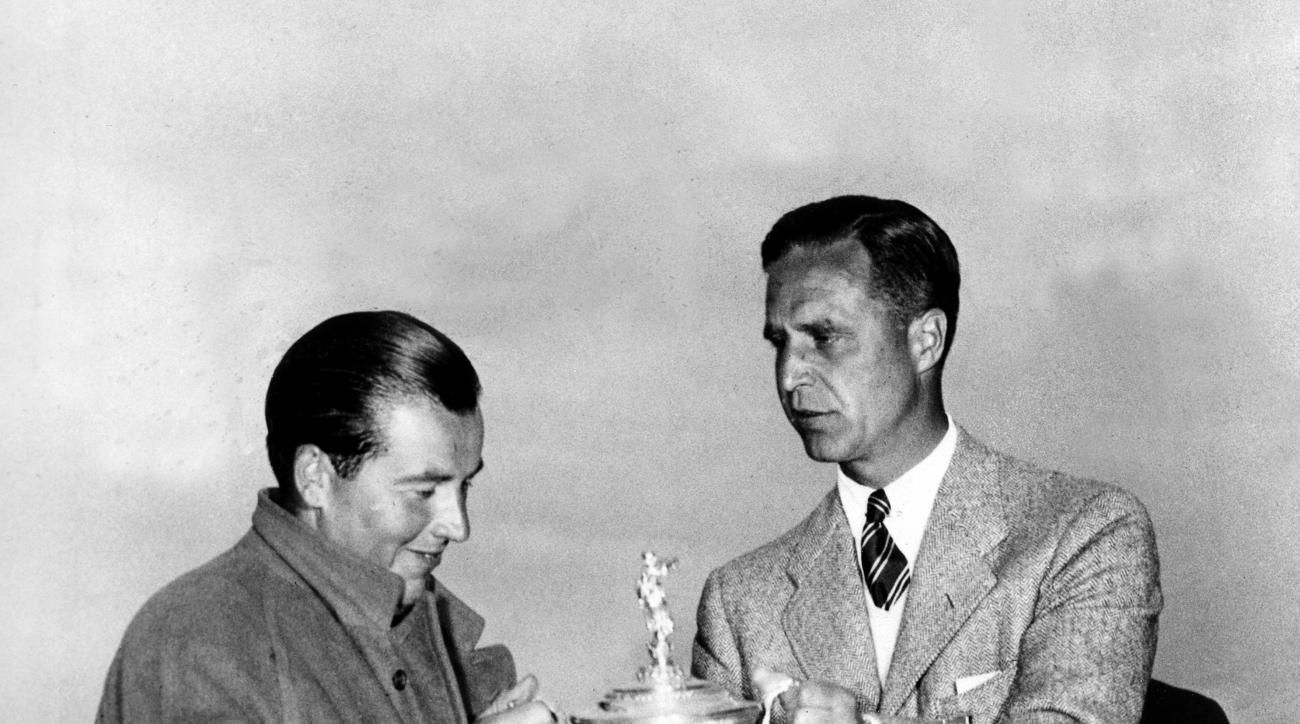 FILE -- In this in this June 8, 1935 file photo, Sam Parks Jr., left, of Pittsburgh, is presented with the trophy cup by Prescott Bush, president of the American Golf Association, after winning the U.S. Open Golf Championship at Oakmont Country Club in Oa