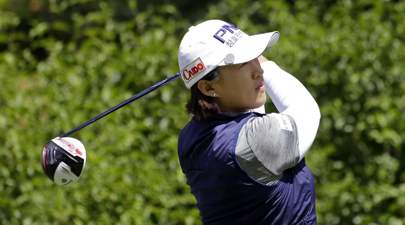 Amy Yang, of South Korea, tees off on the first hole in the final round at the Women's PGA Championship golf tournament at Sahalee Country Club Sunday, June 12, 2016, in Sammamish, Wash. (AP Photo/Elaine Thompson)
