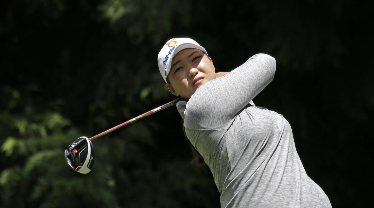 Mirim Lee, of South Korea, tees off on the fourth hole in the final round at the Women's PGA Championship golf tournament at Sahalee Country Club on Sunday, June 12, 2016, in Sammamish, Wash. (AP Photo/Elaine Thompson)