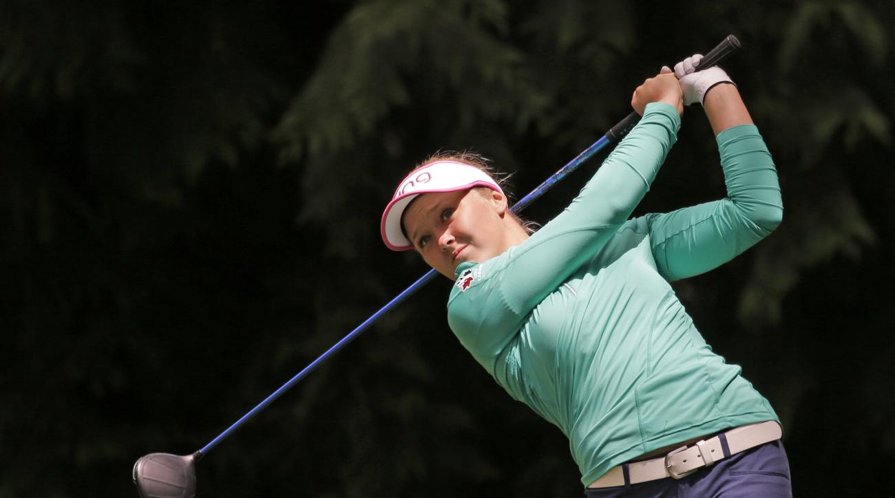 Brooke Henderson tees off on the fourth hole in the final round at the Women's PGA Championship golf tournament at Sahalee Country Club on Sunday, June 12, 2016, in Sammamish, Wash. (AP Photo/Elaine Thompson)
