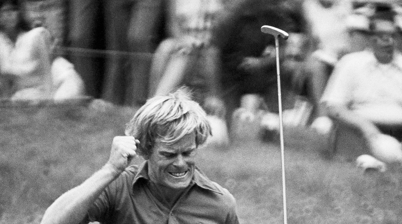 FILE - In this June 17, 1973 file photo, Johnny Miller, a South Carolina golfer who burned up the Oakmont, Pa., course with a 5-under par 279 and a record 63 for the day's round, reacts in his early lead of the U.S. Open Golf championship. (AP Photo, File