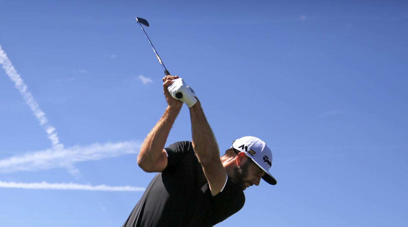 Dustin Johnson hits his tee shot on the par-3 eighth hole during a practice round for the 2016 US Open golf championship, at Oakmont Country Club in Oakmont, Pa., Monday, June 13, 2016. (AP Photo/Gene J. Puskar)