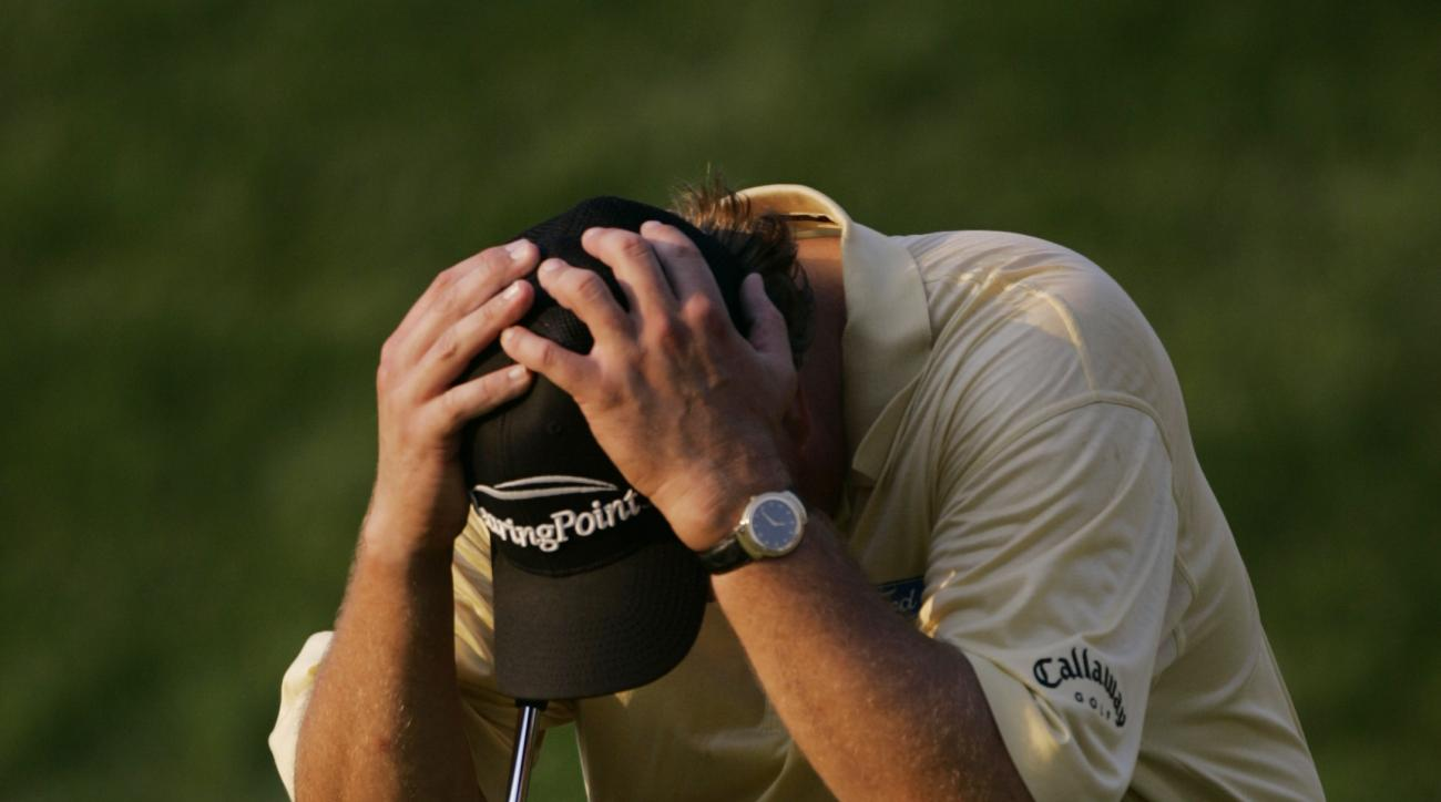 FILE - In this June 18, 2006, file photo Phil Mickelson reacts after double-bogeying the 18th hole in the final round of the U.S. Open golf tournament at Winged Foot Golf Club in Mamaroneck, N.Y. No one has suffered more at the U.S. Open than Mickelson, w