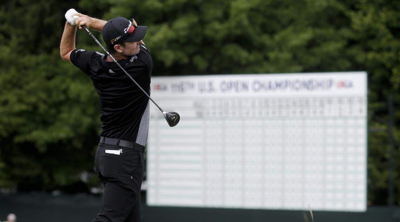Justin Rose, of England, watches his tee shot on the 15th hole during a practice round for the U.S. Open golf championship at Oakmont Country Club on Wednesday, June 15, 2016, in Oakmont, Pa. (AP Photo/John Minchillo)
