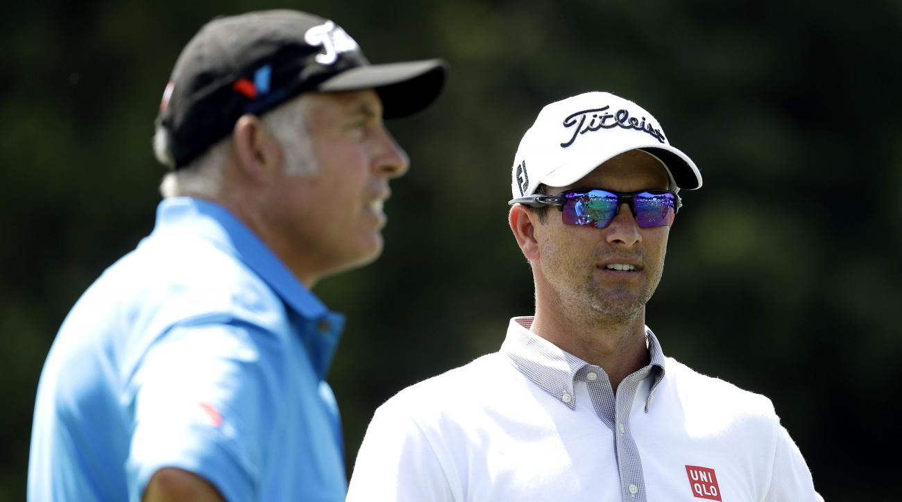 Adam Scott, of Australia, right, talks with his caddie, Steve Williams on the range during a practice round for the U.S. Open golf championship at Oakmont Country Club on Wednesday, June 15, 2016, in Oakmont, Pa. (AP Photo/Charlie Riedel)