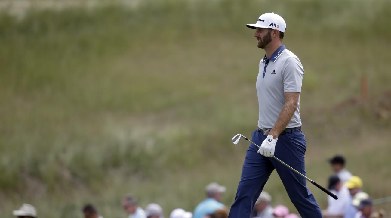 Dustin Johnson walks to the 12th hole during a practice round for the U.S. Open golf championship at Oakmont Country Club on Wednesday, June 15, 2016, in Oakmont, Pa. (AP Photo/John Minchillo)