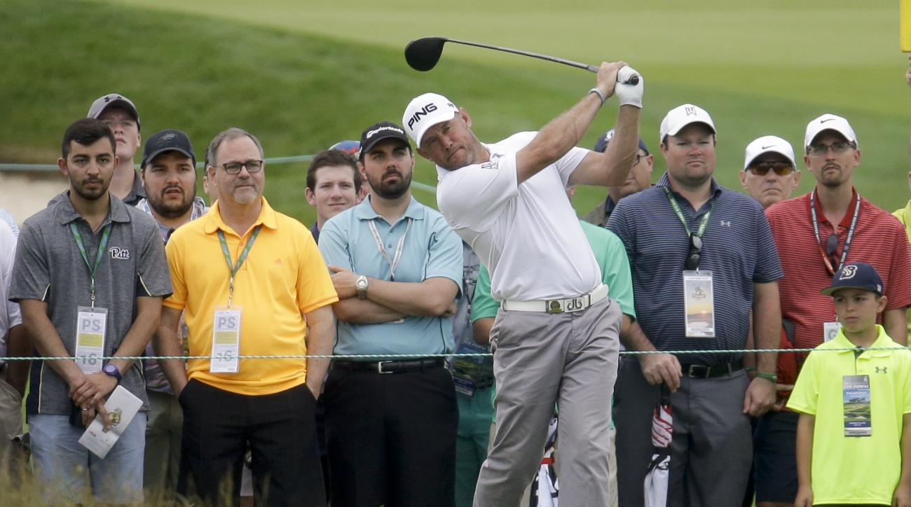 Lee Westwood, of England, watches his tee shot on the 14th hole during the first round of the U.S. Open golf championship at Oakmont Country Club on Thursday, June 16, 2016, in Oakmont, Pa. (AP Photo/John Minchillo)