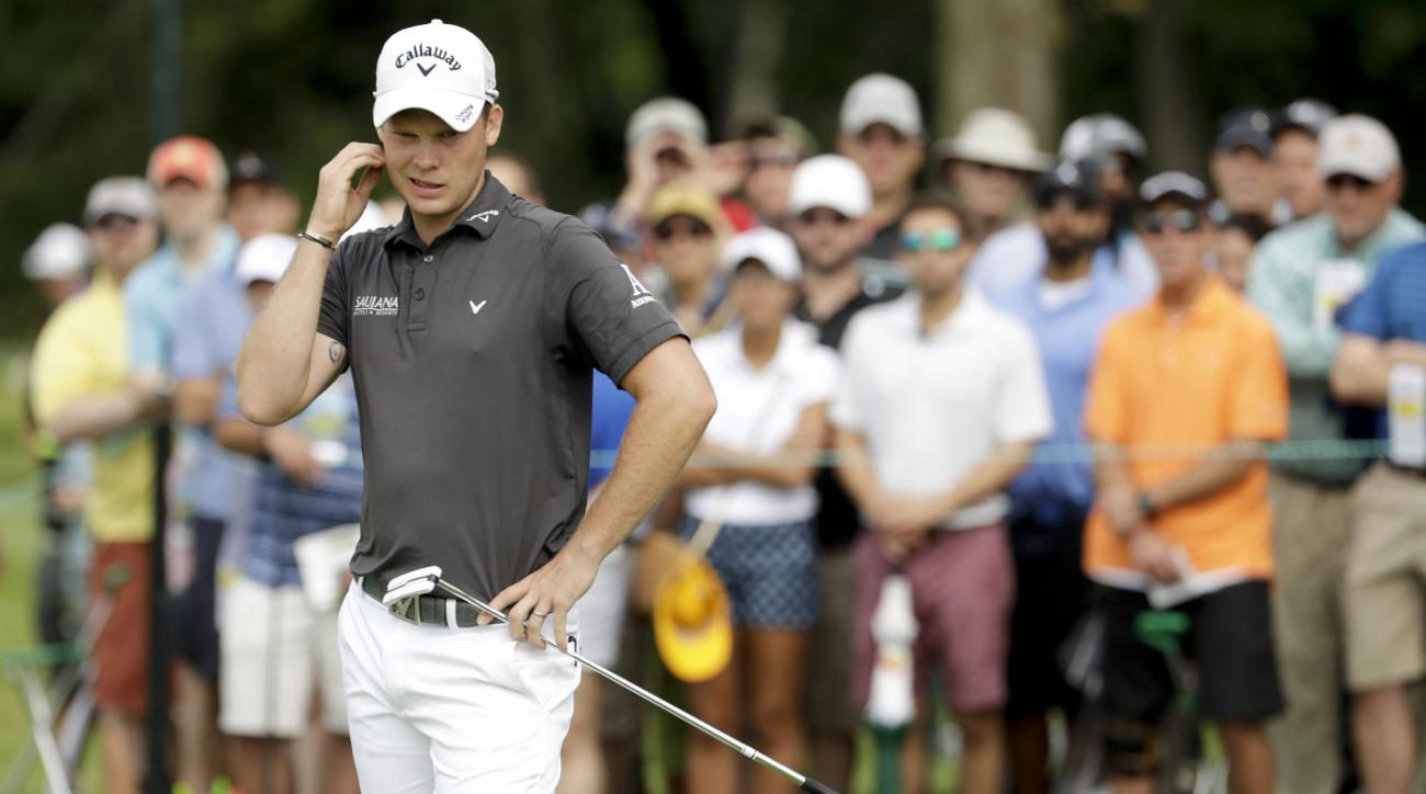 Danny Willett, of England, watches his putt on the sixth hole during the first round of the U.S. Open golf championship at Oakmont Country Club on Thursday, June 16, 2016, in Oakmont, Pa. (AP Photo/Charlie Riedel)