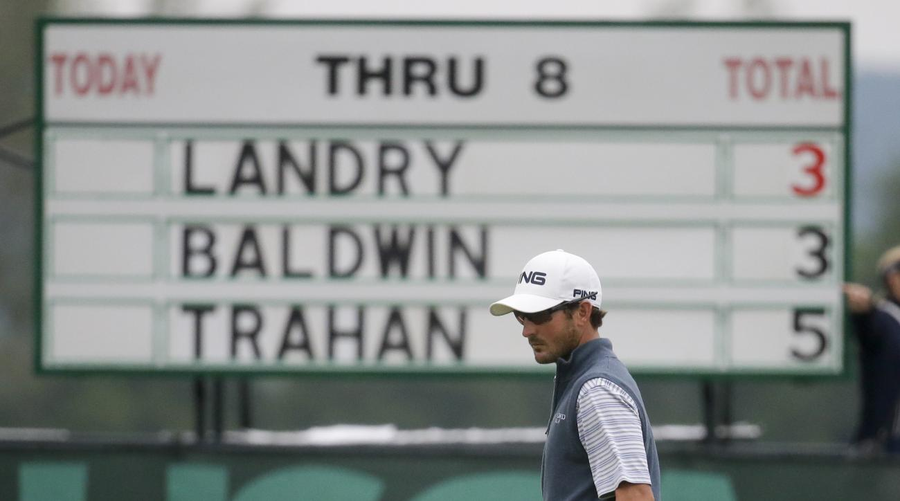 Andrew Landry lines up his putt on the ninth hole during the rain delayed first round of the U.S. Open golf championship at Oakmont Country Club on Friday, June 17, 2016, in Oakmont, Pa. (AP Photo/John Minchillo)