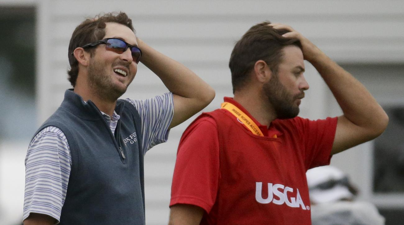 Andrew Landry, left, and his caddie Kevin Ensor react after completing the rain delayed first round of the U.S. Open golf championship at Oakmont Country Club on Friday, June 17, 2016, in Oakmont, Pa. (AP Photo/John Minchillo)