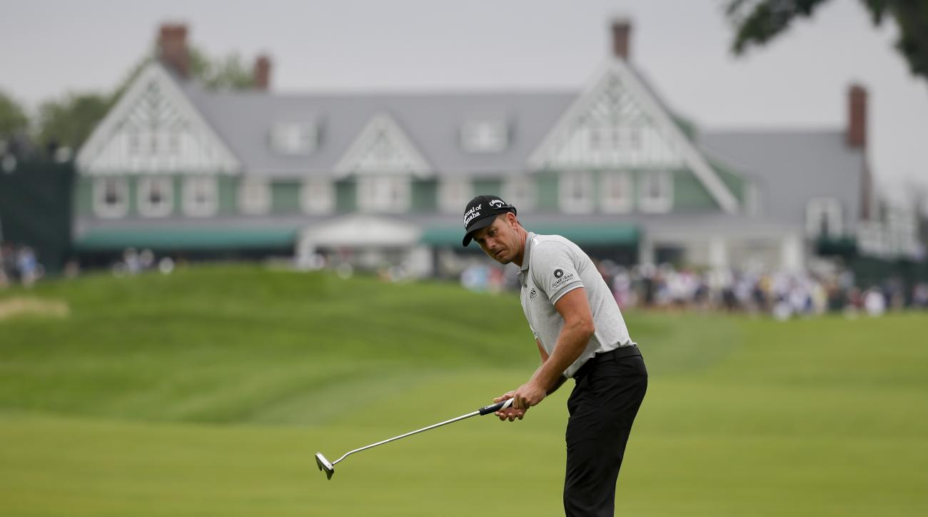 Henrik Stenson, of Sweden, watches his putt on the 10th hole during the rain delayed first round of the U.S. Open golf championship at Oakmont Country Club on Friday, June 17, 2016, in Oakmont, Pa. (AP Photo/Gene J. Puskar)